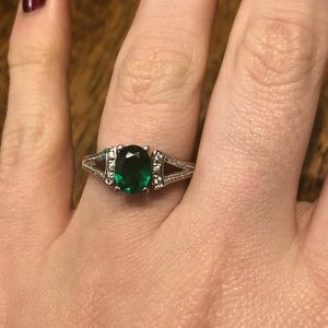 Size 7 silver ring with green stone